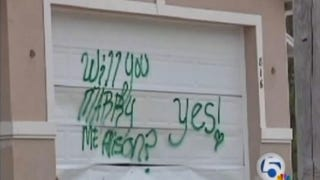 Illustration for article titled Marriage Proposal Spray Painted On Stranger's Garage