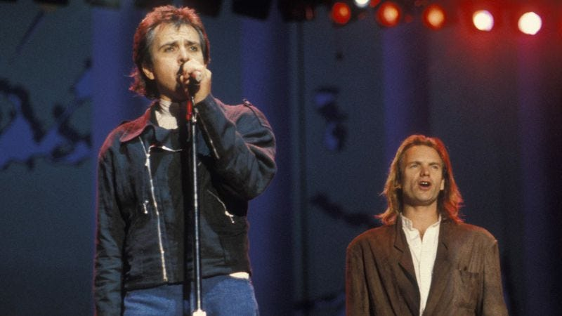 Peter Gabriel and Sting, together at an Amnesty International concert in 1988. (Photo: Getty Images)