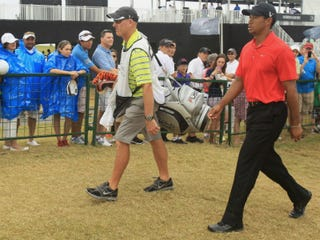 Tiger Woods (right) walks Sunday with his caddie, Joe Lacava.(Scott Halleran/Getty Images)