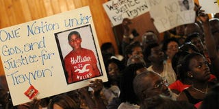Protesters in Sanford, Fla., attend a town hall meeting in March, 2012. (Gerardo Mora/Getty Images)