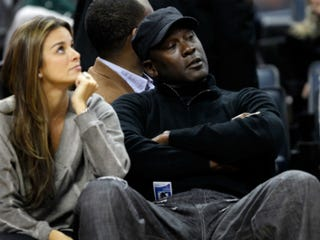 Michael Jordan with fiancée Yvette Prieto during a Bobcats game(Streeter Lecka/Getty Images)