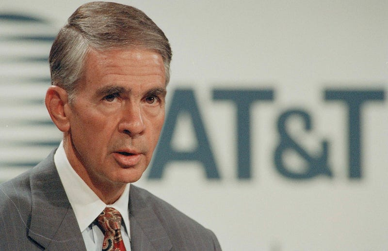 Robert Allen, chairman and CEO of AT&T, addresses a news conference in New York, Aug. 20, 1994. (AP Photo/Mark Lennihan)