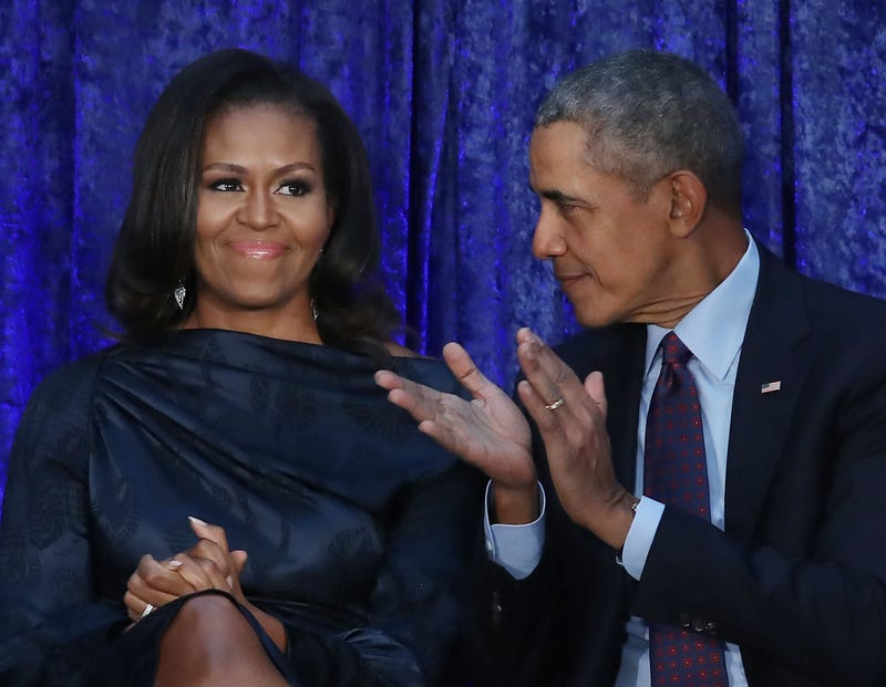 Former President Barack Obama and first lady Michelle Obama participate in the unveiling of their official portraits during a ceremony at the Smithsonian's National Portrait Gallery on Feb. 12, 2018, in Washington, D.C.