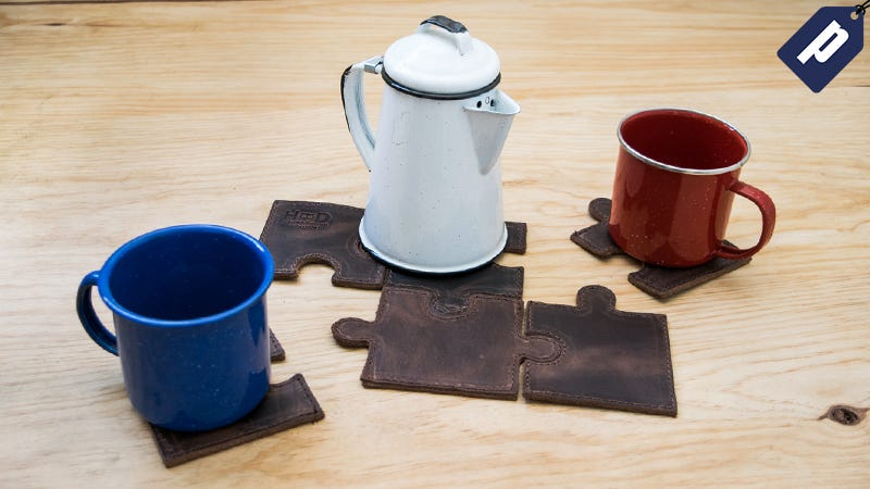 Illustration for article titled Spruce Up Your Coffee Table With These Handmade Puzzle Coasters ($12)