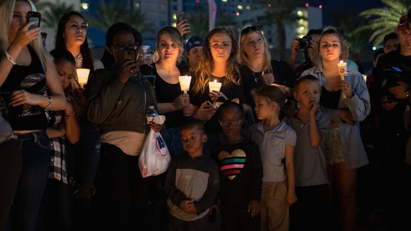 Mourners attend a vigil in Las Vegas on Monday for victims of Sunday's mass murder. Image via Getty.