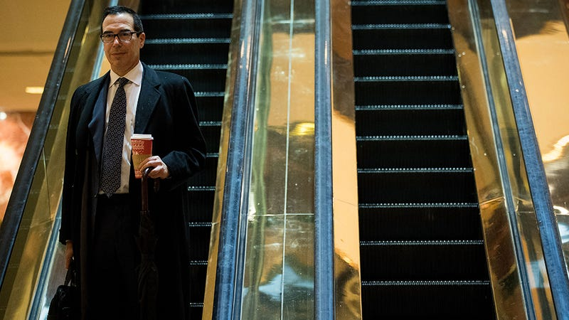 Steve Mnuchin takes the automated stairs. Photo: Getty