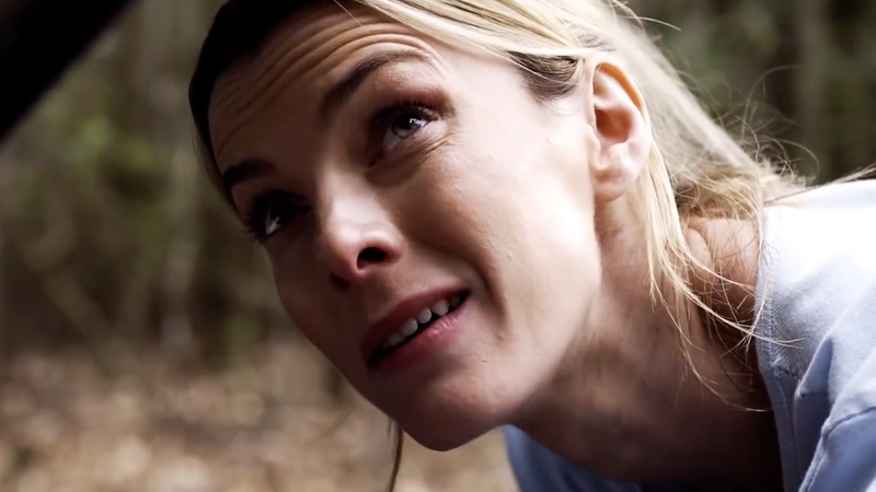 "Betty Gilpin as Crystal, one of the ""deplorables"" being hunted."