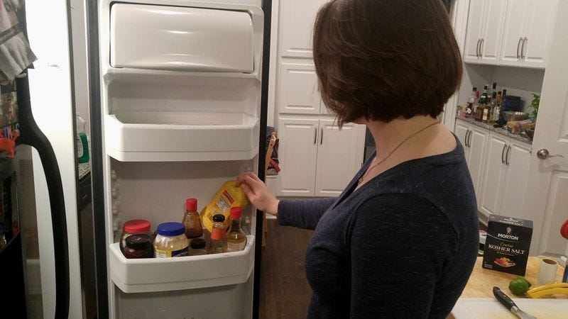 Illustration for article titled Woman Rearranging Condiments In Refrigerator Door Like Puzzle In Ancient Tomb