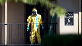 A hazardous-materials team member arrives Oct. 3, 2014, to clean a unit at the Ivy Apartments in Dallas where the confirmed Ebola virus patient Thomas Eric Duncan had been staying.Joe Raedle