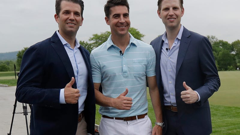 Donald Trump Jr., left, and Eric Trump, right, pose for a photograph with Jesse Watters prior to the start of a news conference previewing the U.S. Women's Open Championship at Trump National Golf Club, Wednesday, May 24, 2017, in Bedminster, N.J