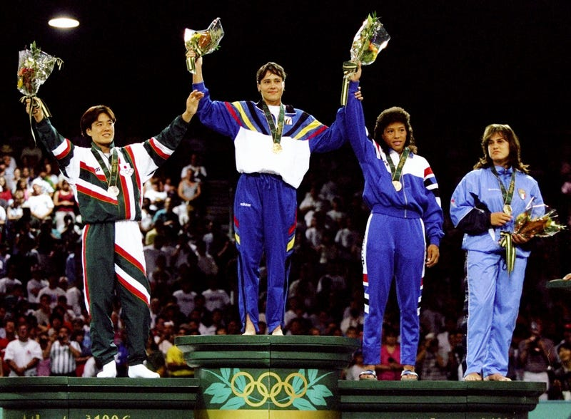 Ulla Werbrouck of Belgium, gold, Yoko tanabe of Japan, silver, Ylenia Scapin of Italy and Diadenis luna of Cuba, bronze for the 72kg Women''s Half-Heavyweight Judo event at the 1996 Centennial Olympic Games. Photo via Getty Images.