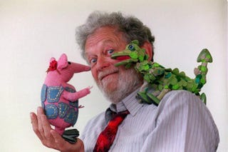 Peter Firmin with one of the Clangers and the Soup Dragon.