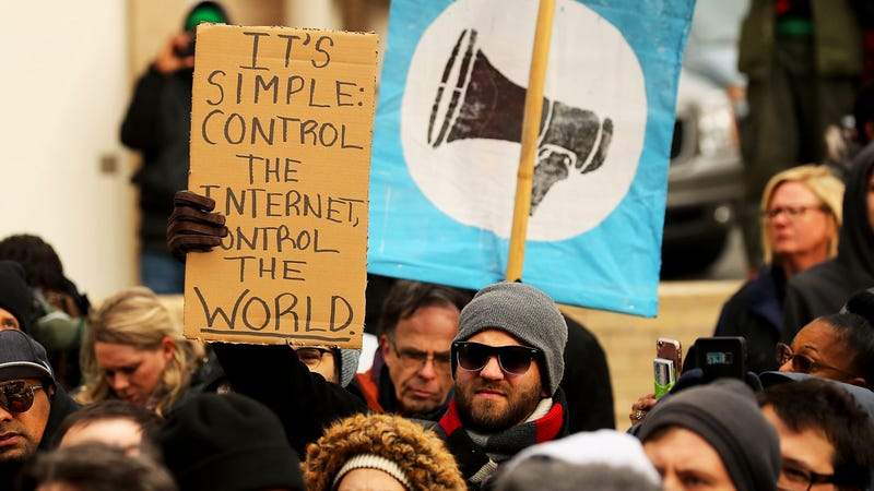 Demonstrators rally outside the Federal Communication Commission building to protest against the end of net neutrality rules December 14, 2017 in Washington, DC.