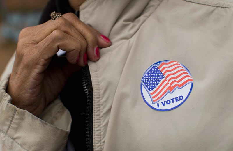 "A voter shows off her ""I Voted"" sticker as she leaves a polling place Nov. 4, 2014, in Ferguson, Mo.Scott Olson/Getty Images"