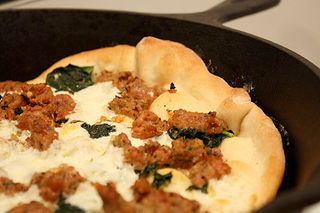 Illustration for article titled Cook Pizza in a Cast-Iron Skillet