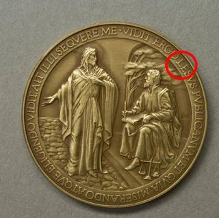 Illustration for article titled Vatican misspells Jesus on Pope Francis commemorative coins