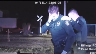 Montana police Officer Grant Morrison (left) and another officer at the scene of the fatal April shooting of Richard Ramirez.YouTube