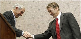 Rand Paul, right, and his father, Ron Paul (Washington Post)