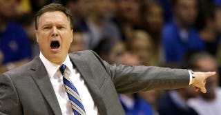 Illustration for article titled Bill Self Gets Crushed By Court-Stormers, Is Not Pleased