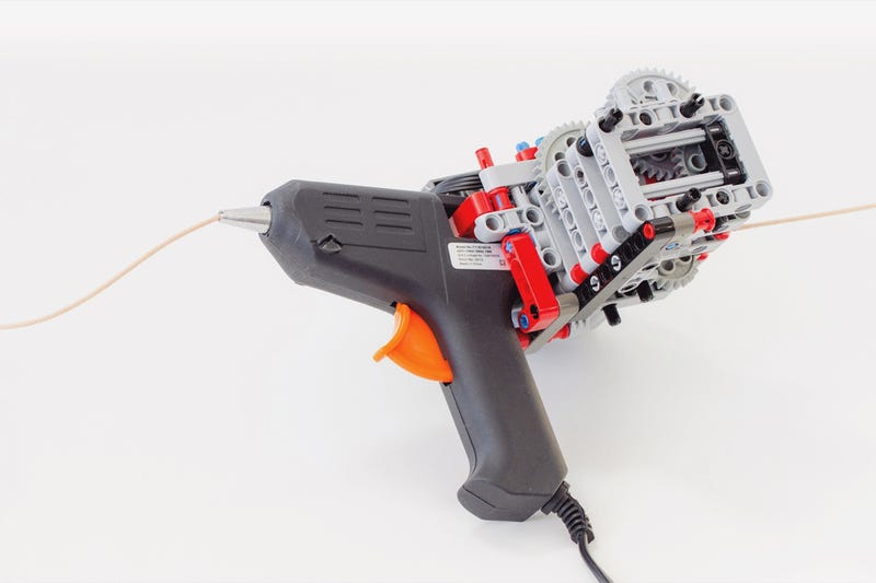 Illustration for article titled This Lego-Modded Glue Gun is A Handheld 3D Printer