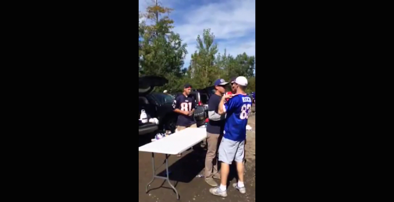 Illustration for article titled Bills Fan Uses Teamwork To Slam Patriots Fan Through Table