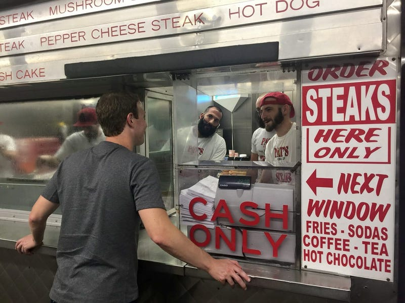 Illustration for article titled Mark Zuckerberg Looking at Employees of the Original Pat's King of Steaks, Possibly to Order a Philly Cheese Steak