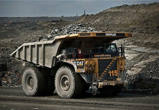 Illustration for article titled These Autonomous Dump Trucks Let Mines Operate Around the Clock