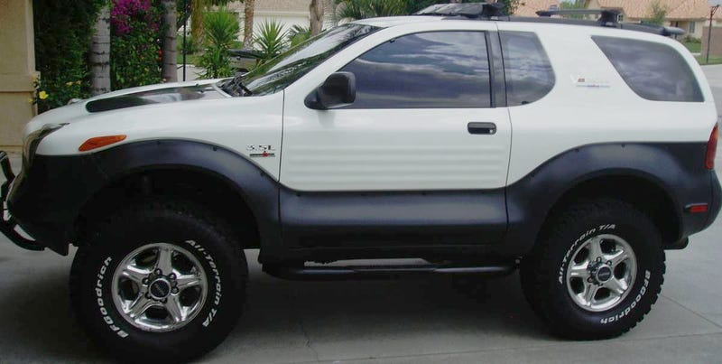 Illustration for article titled For $13,500, This 1999 Isuzu VehiCROSS Could Let You Pretend You're Robert Downey Jr… Or Ozzy Osbourne
