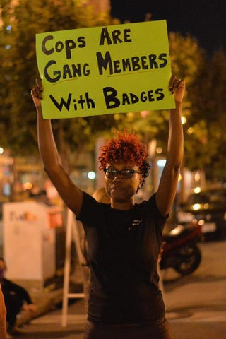 A woman holds a sign during a protest in St. Louis Aug. 20, 2015. Michael B. Thomas/Getty Images