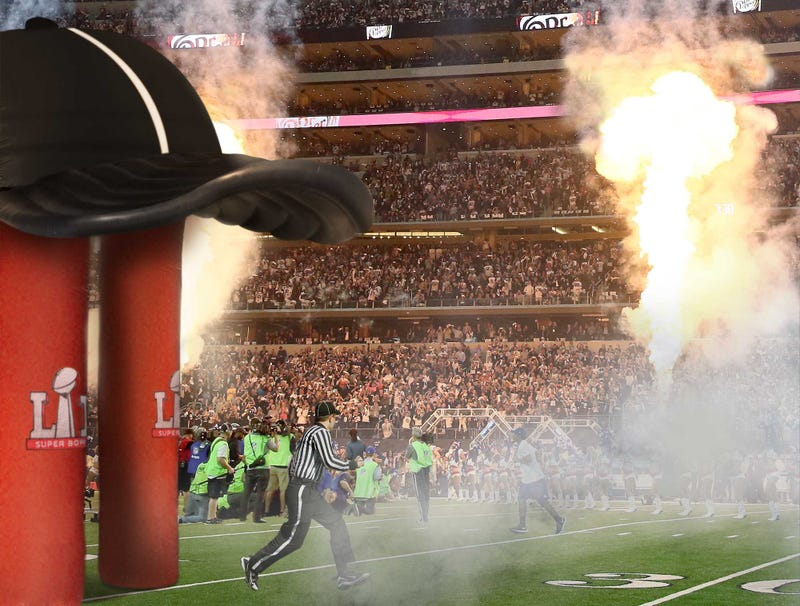 Illustration for article titled Official Sprints Through Giant Inflatable Referee Hat To Take Field For Super Bowl