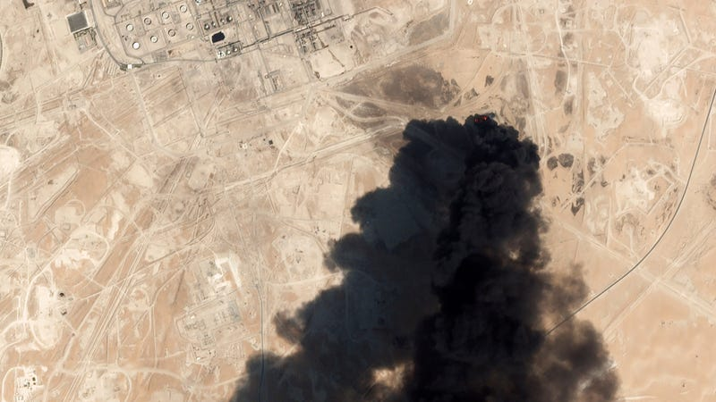This Saturday, Sept. 14, 2019, satellite image from Planet Labs Inc. shows thick black smoke rising from Saudi Aramco's Abqaiq oil processing facility in Buqyaq, Saudi Arabia.