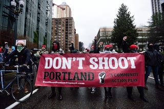 Protesters block a street during a rally in Portland, Ore., on Feb. 20, 2017. A small group blocked the street to protest not only President Trump, but the recent fatal police shooting of Quanice Hayes. (Alex Milan Tracy/Anadolu Agency/Getty Images)