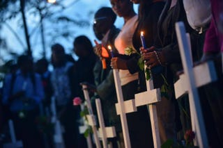 People hold candles alongside wooden crosses at Freedom-Corner in Uhuru Park in Nairobi, Kenya, April 7, 2015, during a vigil for the victims of an attack claimed by Somalia's al-Qaida-linked al-Shabab insurgents at Garissa University College, in which 148 people were killed.TONY KARUMBA/AFP/Getty Images