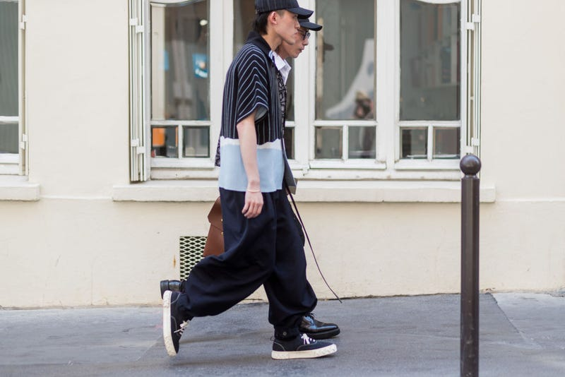 Are these fashion week attendees off to the laundromat? Who knows! / Image via Getty