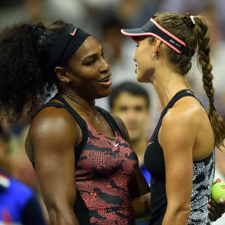 Serena Williams and opponent Vitalia Diatchenko meet at the net after Diatchenko withdrew during their women's singles round 1 match at the U.S. Open in New York City Aug. 31, 2015.Don Emmert/AFP/Getty Images