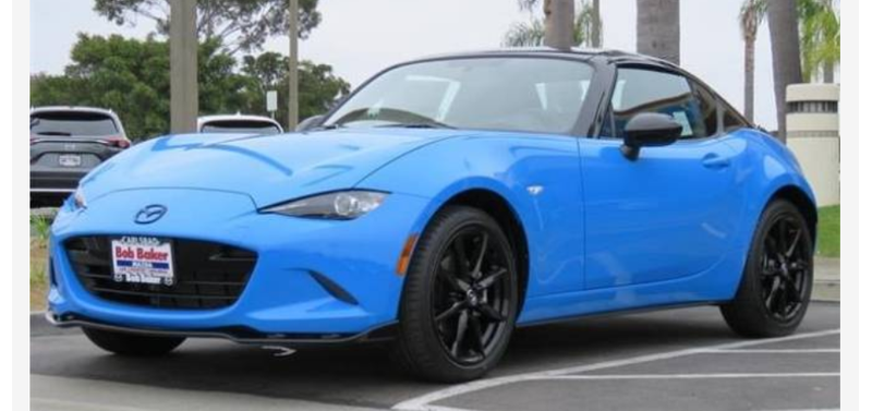 Two-tone with the only good Mazda color. THE ONLY ONE. Time to go special-order one of these with a manual...