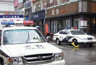 Illustration for article titled In Beijing, Even Cops Can't Park Illegally