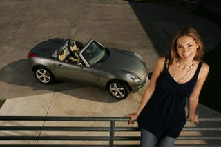 Illustration for article titled Jalopnik Question Of The Day: Is GM Designer Vicki Vlachakis Hotter Than The Pontiac Solstice?