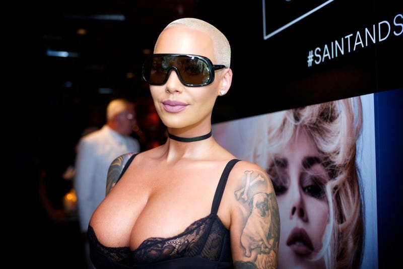 Amber Rose is considering breast reduction surgery to downsize 'stupid heavy boobs'