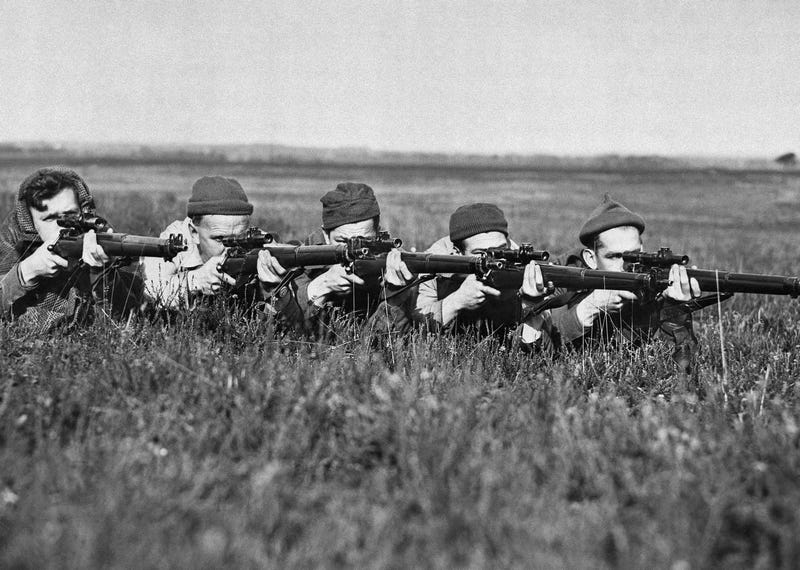 Canadian snipers get some last minute training in England, May 9, 1944, as all await D-day. From left to right are : J. J. Showers, Montreal; C.H.Gerrard, Tottenham, Ont.; W. G. Bettridge, Brampton, Ont.; W.A.Lyons, Toronto and L.H. Oddy, Toronto. (AP Photo)