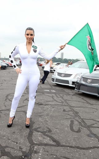 Illustration for article titled Battle Of The Bullrun Booty: Kim Kardashian Or The CTS-V Coupe?