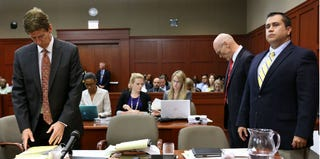 George Zimmerman (right) with defense attorneys Don West and Mark O'Mara (pool/Getty Images)