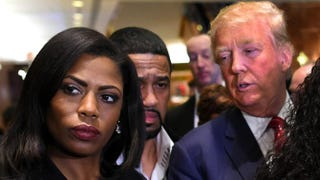 Omarosa Manigault, who was a contestant on the first season of Donald Trump's The Apprentice and is now an ordained minister, appears alongside the Republican presidential hopeful during a press conference Nov. 30, 2015, that followed Trump's meeting with a group of African-American pastors in New York City.TIMOTHY A. CLARY/AFP/Getty Images