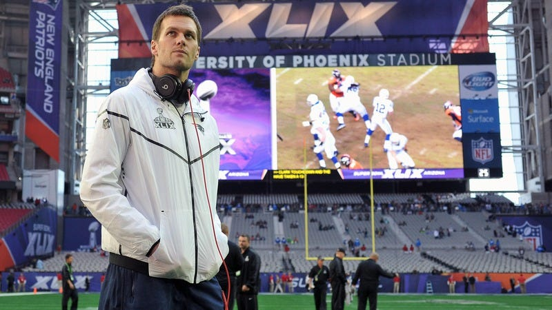 Tom Brady stands on the field before Super Bowl XLIX. (Photo: Keith Nordstrom/New England Patriots)