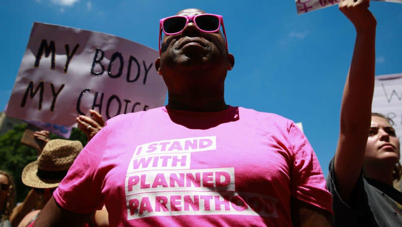 "A protester wears an ""I stand with Planned Parenthood"" shirt at a May 21, 2019, rally in Atlanta against recently passed abortion ban bills."