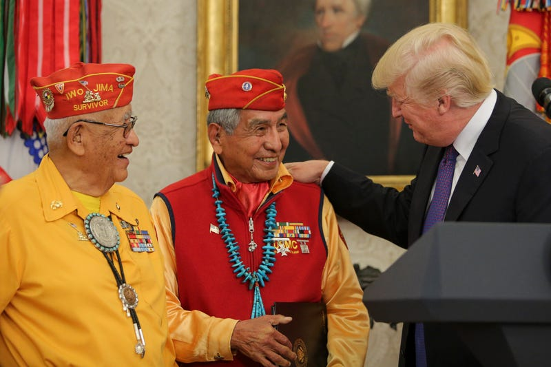 President Donald Trump (right) greets members of the Native American code talkers during an event in the Oval Office of the White House on Nov. 27, 2017, in Washington, D.C. (Oliver Contreras-Pool/Getty Images)