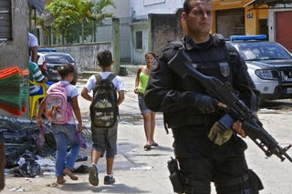 A police officer patrols a favela (shantytown).