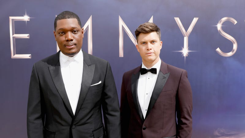 Hosts Michael Che and Colin Jost, who aren't UNhappy to be there