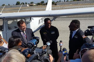 Isaiah Cooper (center), 16, of Compton, Calif., who has become the youngest black pilot to fly across the U.S.Screenshot