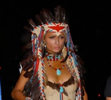 Paris showed up at the Playboy Mansion in L.A. wearing something like the  seductive squaw  costume that our brosite deemed racist.  sc 1 st  Jezebel & Paris Hilton Goes As Insensitive Racist For Halloween